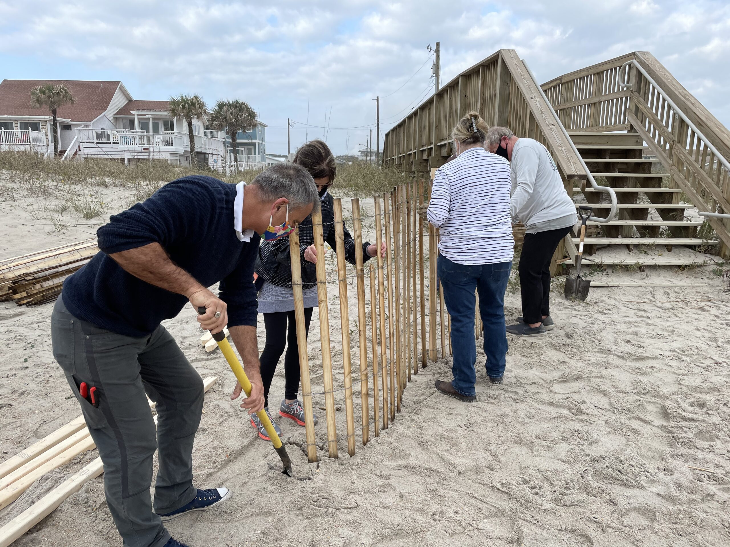 Volunteers install sand fence as part of a municipal dune restoration on the north end Amelia Island dune restoration